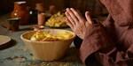 MONK EATING PRAYING