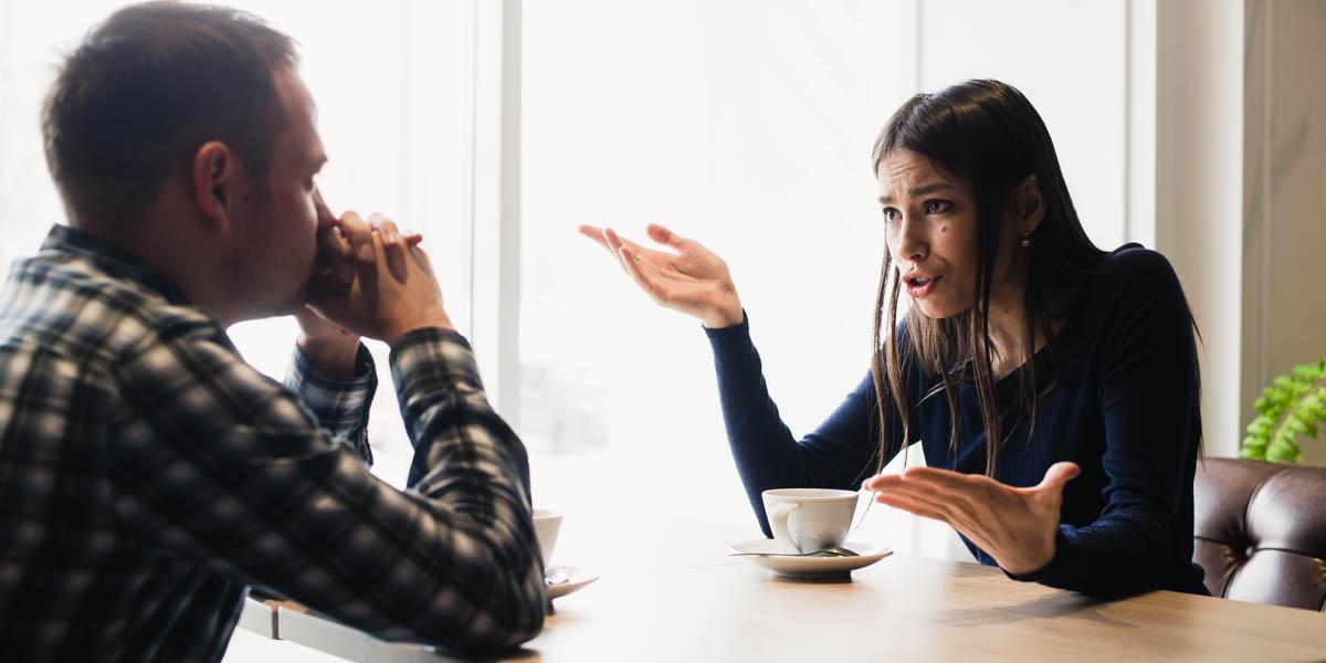 WOMAN AND MAN CONVERSING