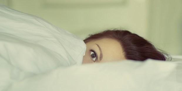 WOMAN,BED,AWAKE
