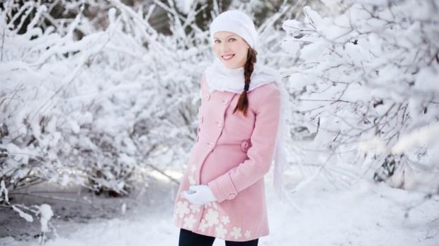 Pregnant woman in winter