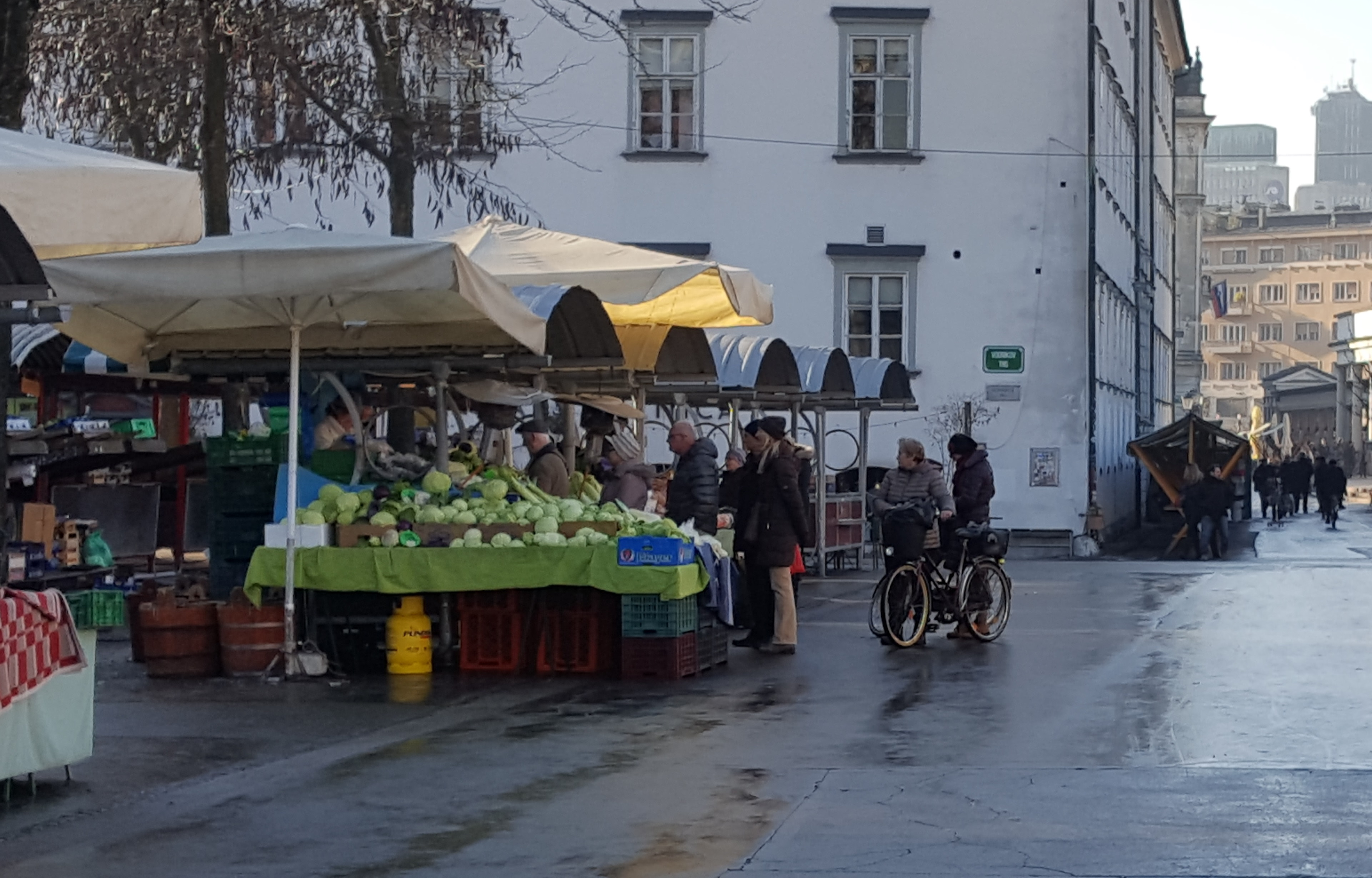 People buying sauerkraut on market in Ljubljana