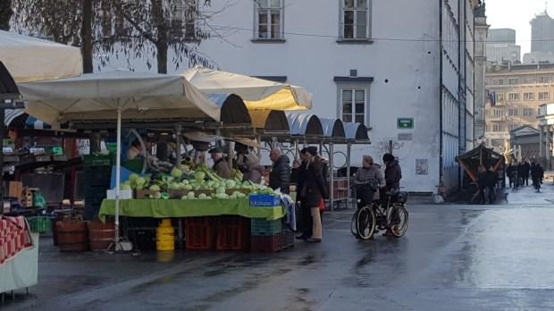 People buying sauerkraut on market in Ljubljana
