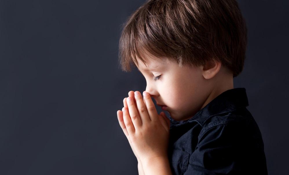 BOY PRAYING