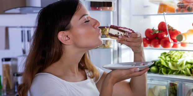 WOMAN EATING SWEET