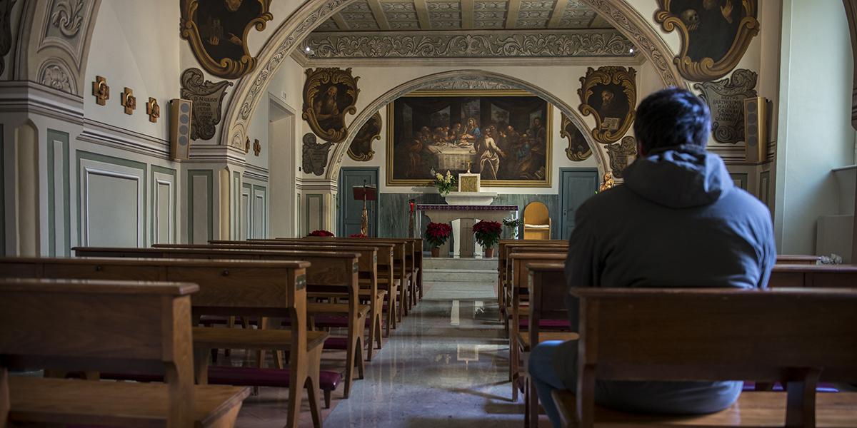 MAN PRAYING CHURCH