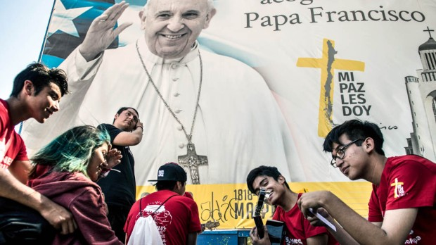 YOUTH AWAITING THE ARRIVAL OF THE POPE