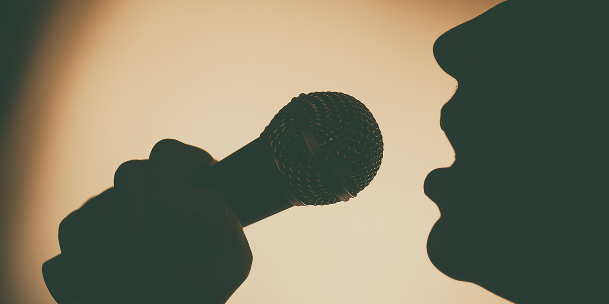 SINGING INTO MICROPHONE