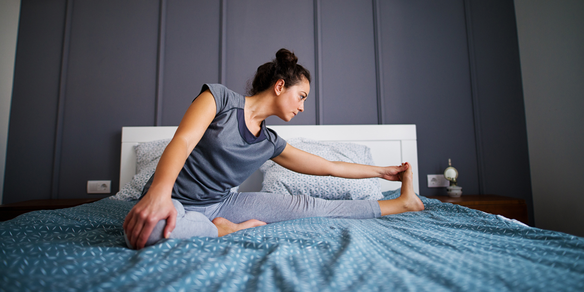WOMAN,EXERCISE,BED