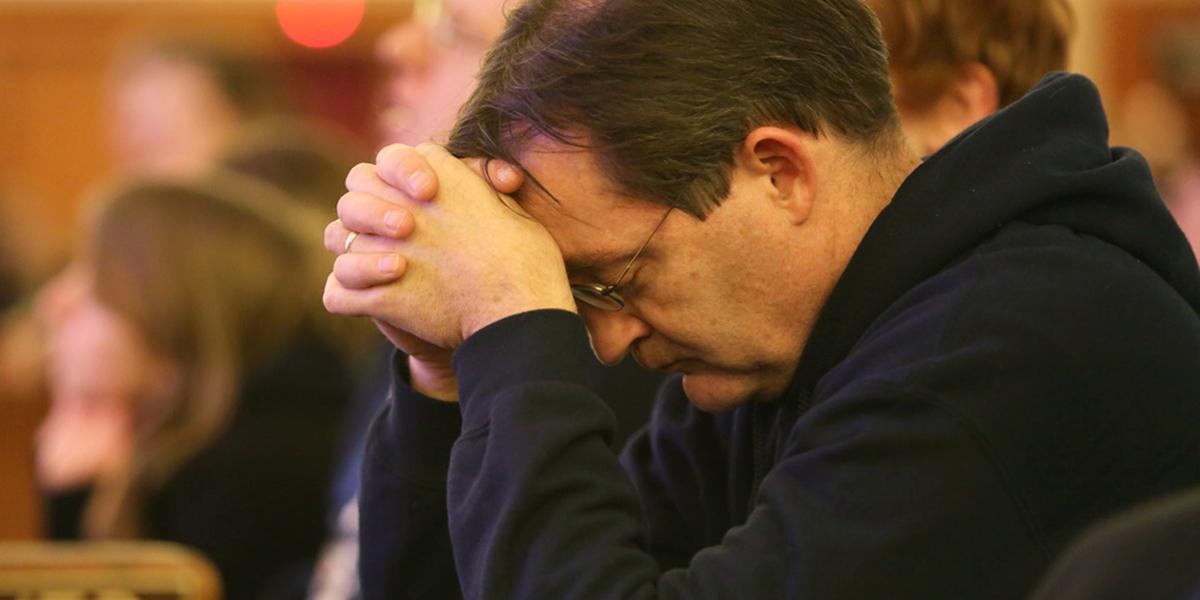 MAN,PRAYING,MASS