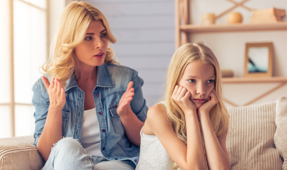 MOTHER TALKING WITH HER DAUGHTER
