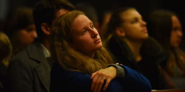 YOUNG WOMAN IN CHURCH