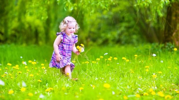 LITTLE GIRL PLAYING GARDEN