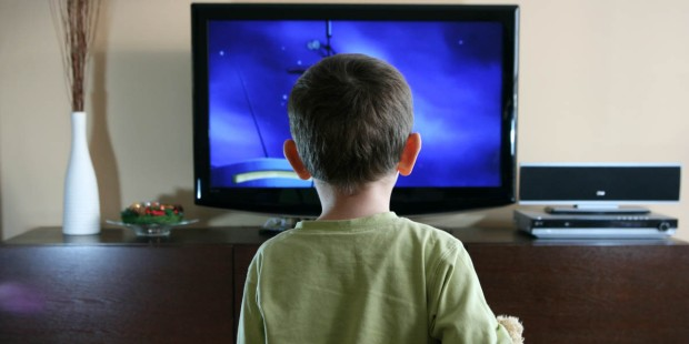 KID IN FRONT OF A TV