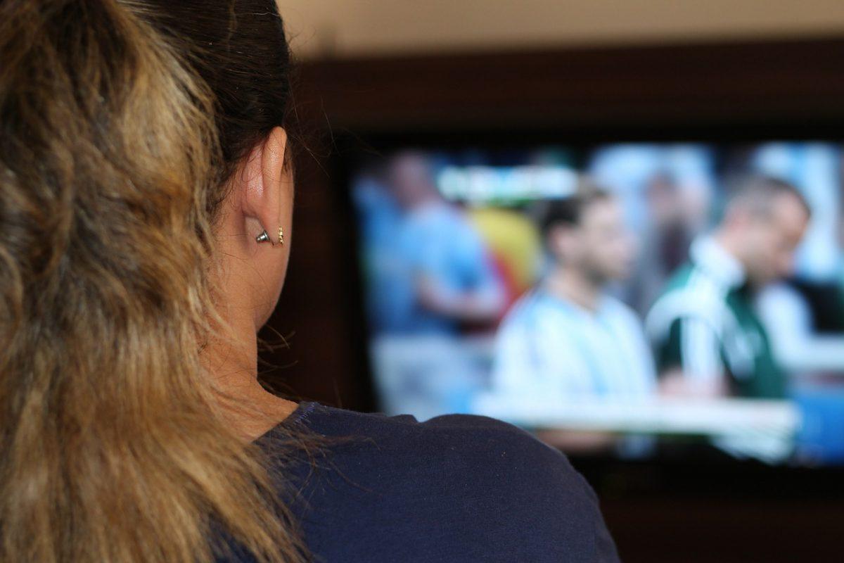 WOMAN WATCHING FOOTBALL