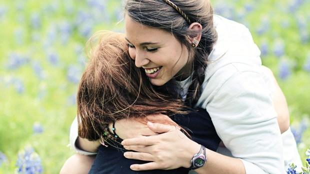 SISTERS HUGGING