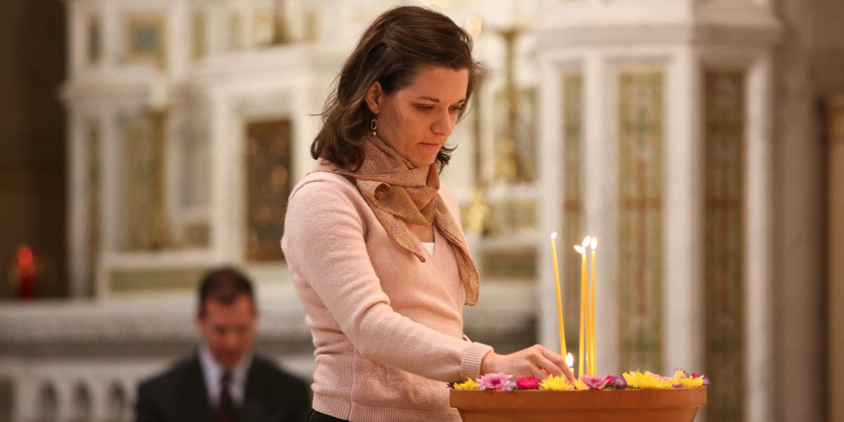 WOMAN,MASS,CANDLES