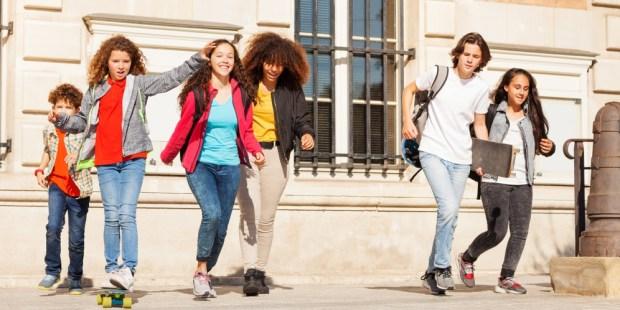 Happy teens having fun at school