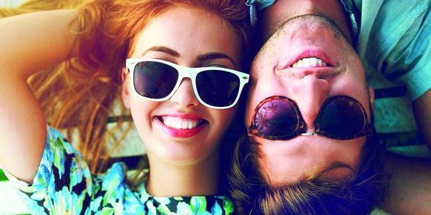 Happy couple portraits wearing sunglasses