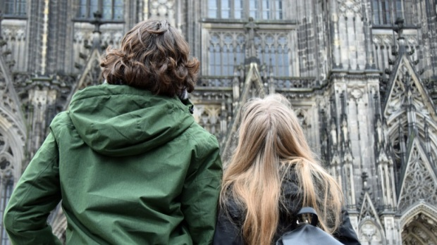 COUPLE IN FRONT OF CATHEDRAL