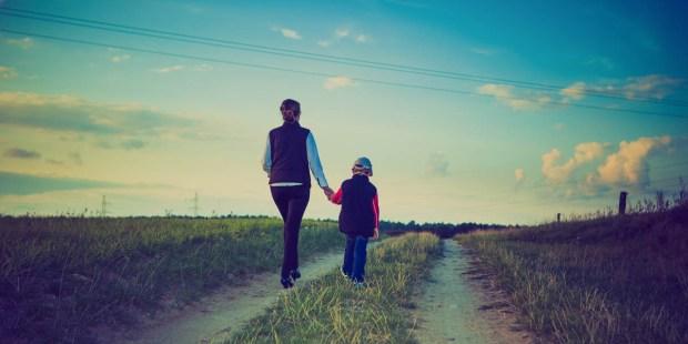 WOMAN CHILD WALKING ON PATH