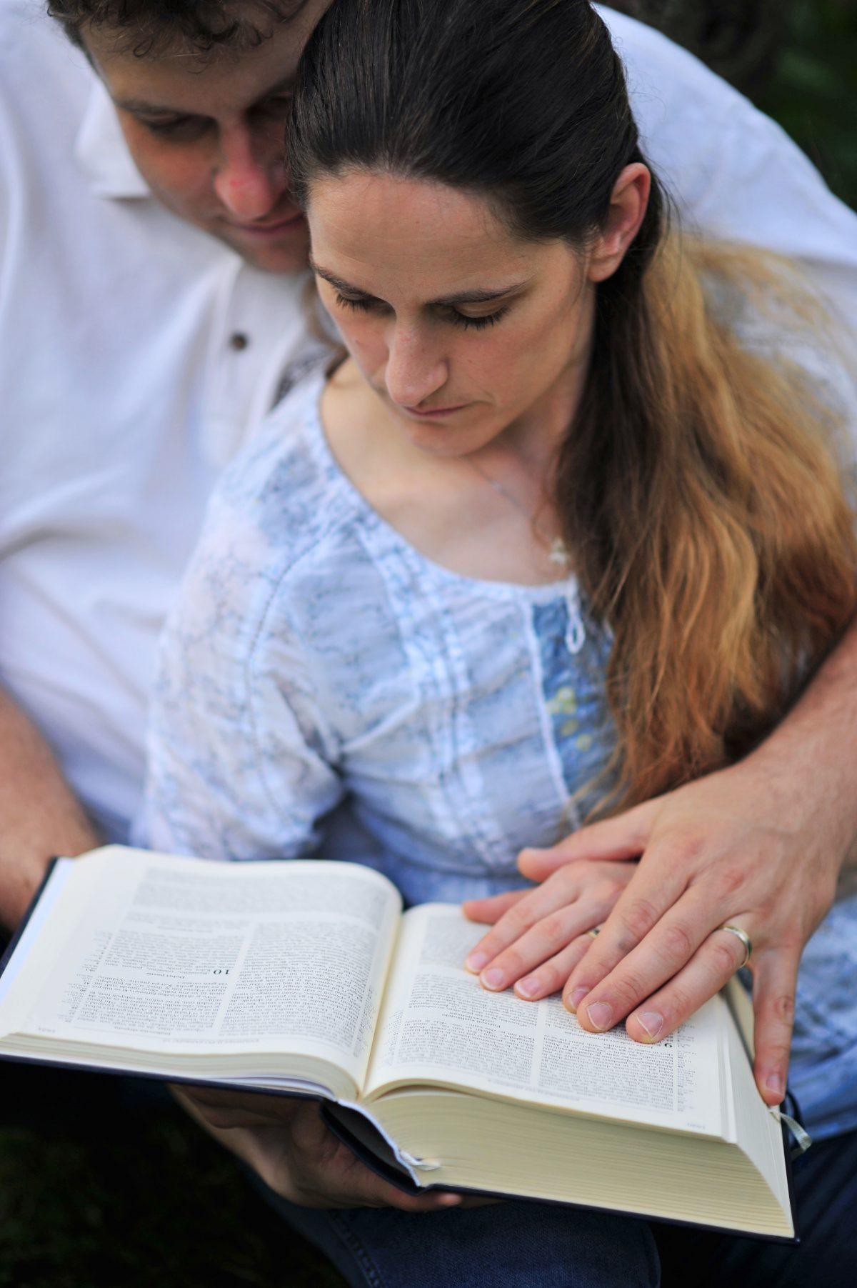 COUPLE READING BIBLE