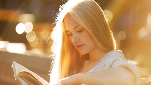 girl sitting and reading book