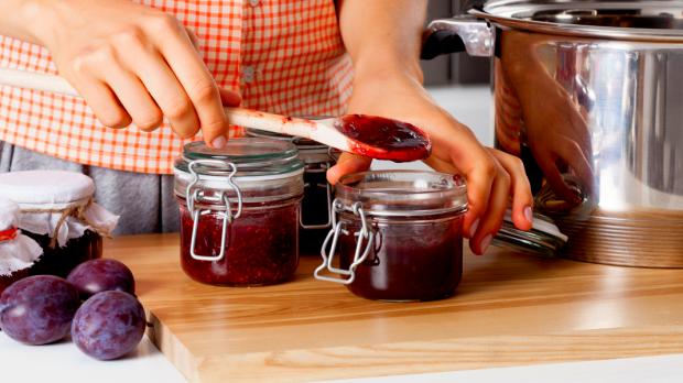 woman making fruit jam