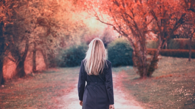 woman walks in the park in autumn