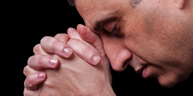 MATURE MAN PRAYING,
