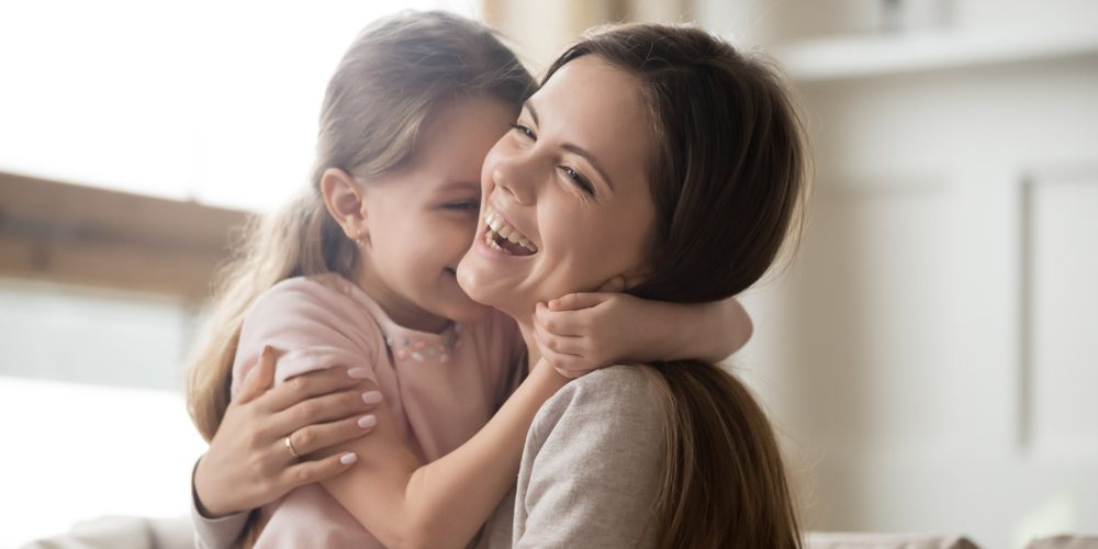 MOTHER DAUGHTER LAUGHING
