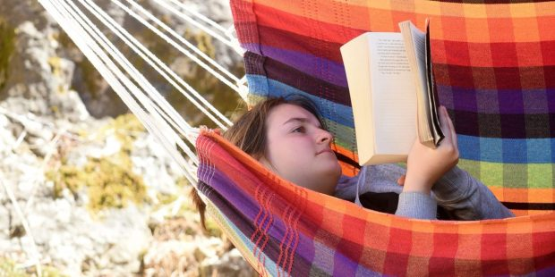 TEEN READING BOOK SUMMER