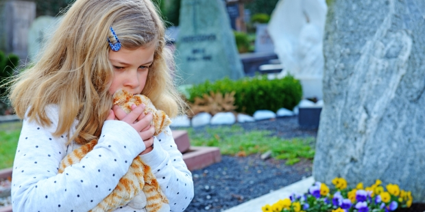 CHILD AT GRAVE