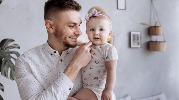 DAD HOLDING CHILD