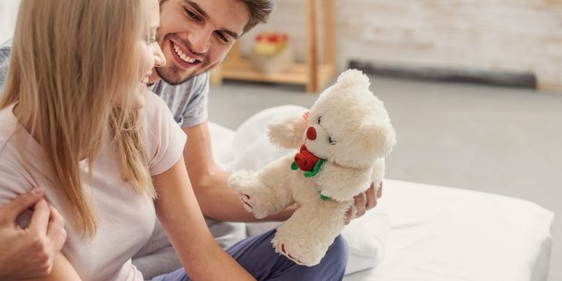 WOMAN RECEIVING TEDDY BEAR